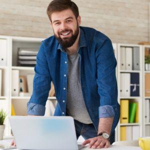bearded-man-enjoying-work-in-office-CWVFUBT.jpg